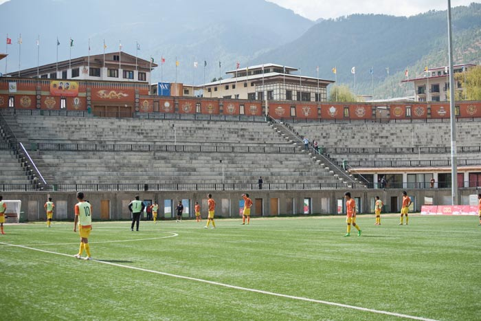 The Bhutan National Football team practices in the national stadium in Thimphu before their match with Sri Lanka.