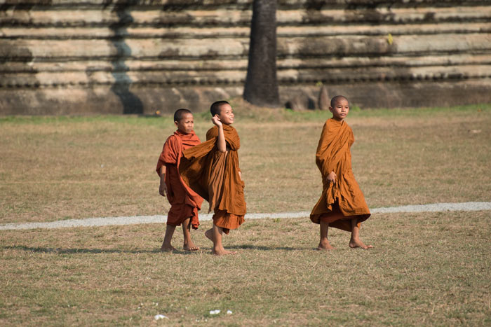 Young monks on the lawn of Angkor Wat. Photo Aaron Lang.
